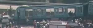 Santiago Metro Train Derails into Condo Complex