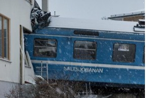 Train Taken by Cleaner Derails Into Building