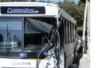 Bus Crashes Cemetery Wall, Injures 2