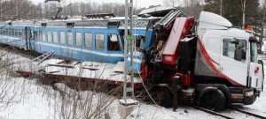 Stockholm Truck struck by electric train at Roslagsbanan